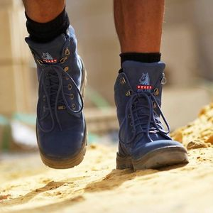 Blue Boots worn by person walking on dirt