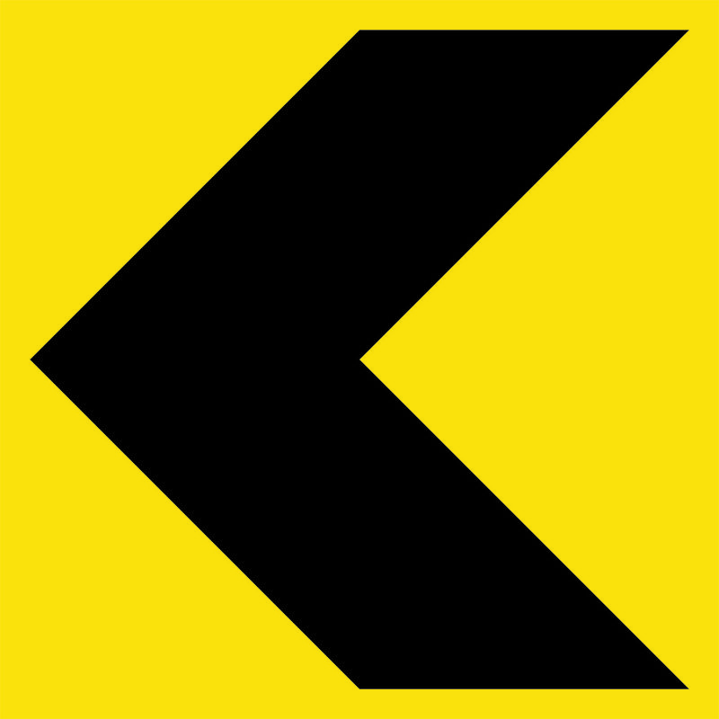 A yellow and black Chevron Sign