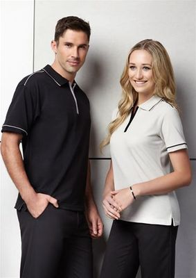 A man and a woman wearing two different coloured Heritage Polo Shirt