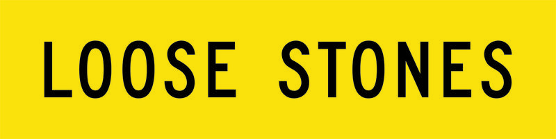 A yellow and black Loose Stones Sign