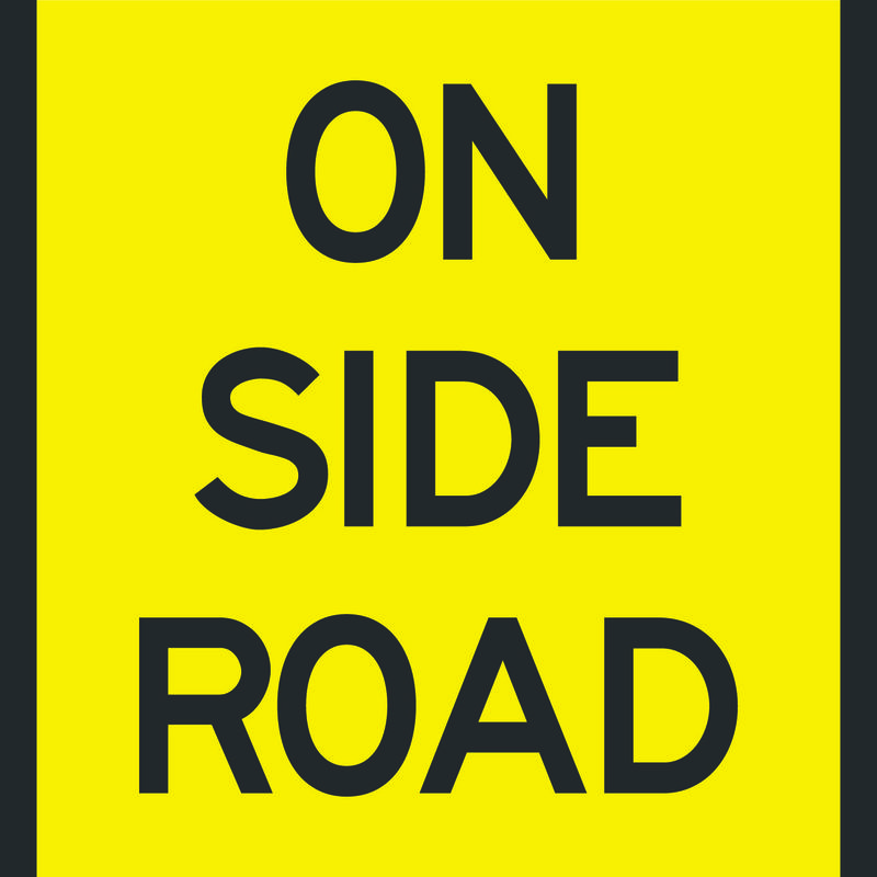 Black and Yellow On Side Road Sign