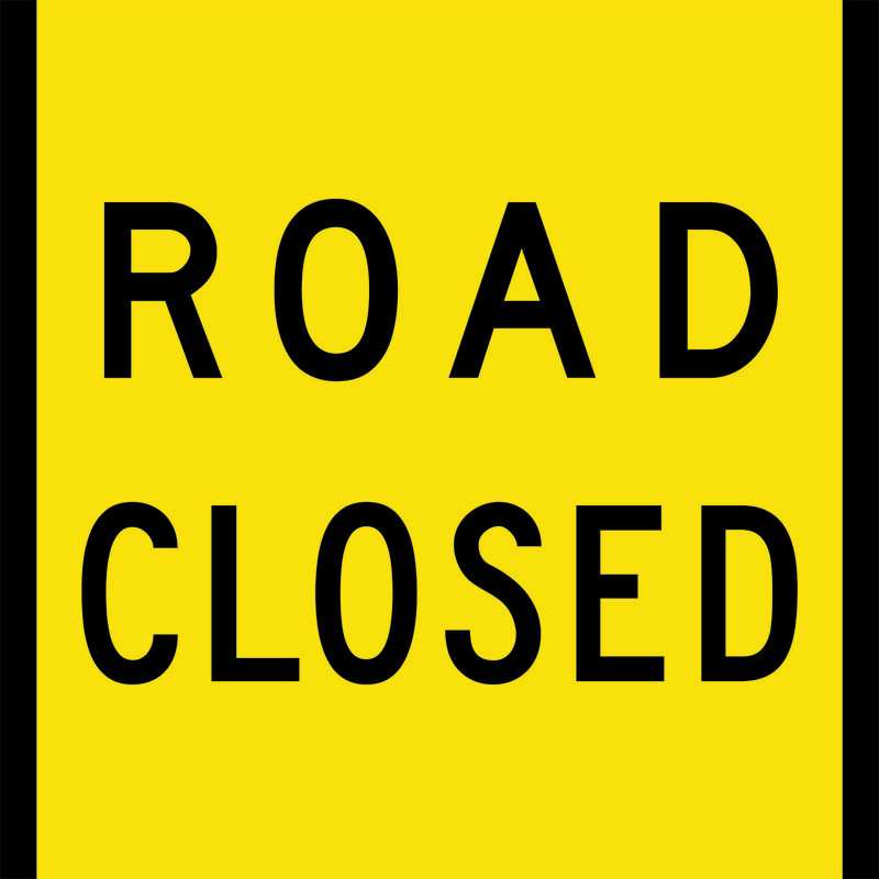 A yellow Road Closed Sign
