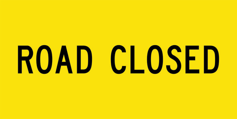 A yellow and black Road Closed Sign