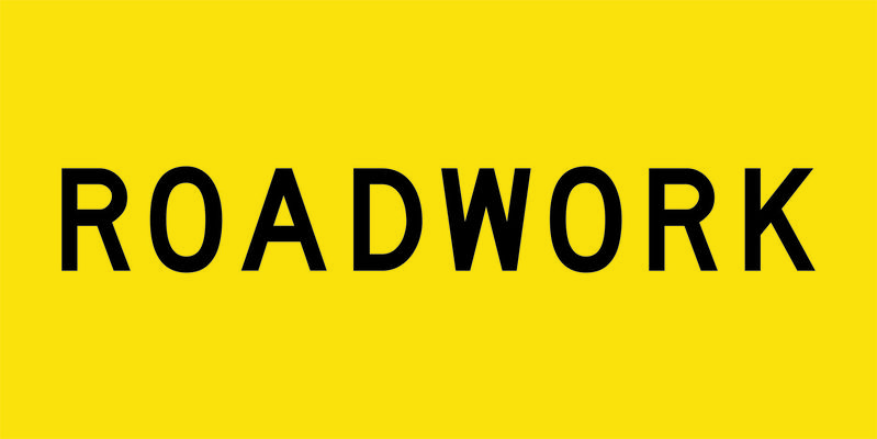 A yellow and black Roadwork Sign