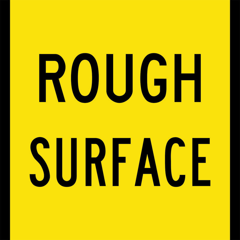 A yellow and black Rough Surface Sign