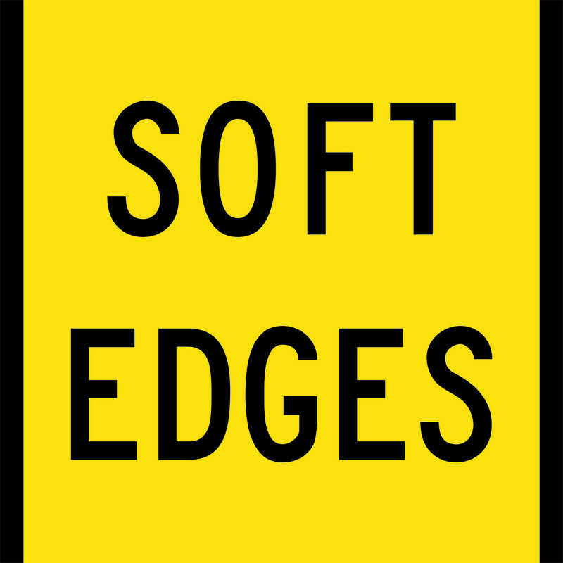 A yellow and black Soft Edges Sign