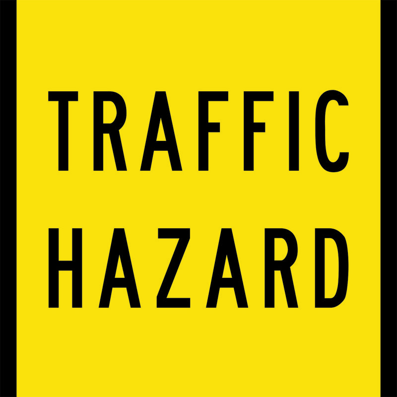 A yellow and black Traffic Hazard Sign