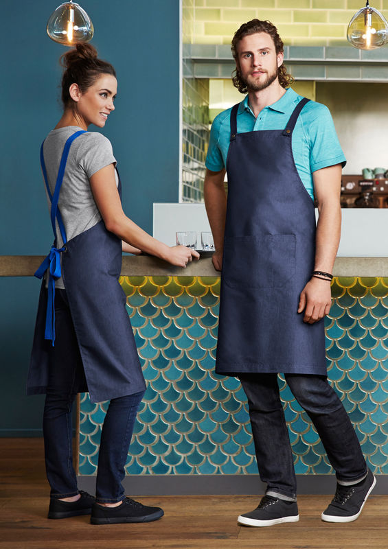 A womand and man in a cafe wearing Urban Bib Aprons