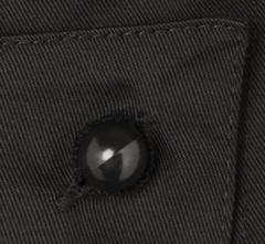 Close up of a black Chef+39s Button in a shirt