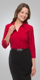 A woman wearing a red Ezylin Ladies 3/4 Sleeve shirt