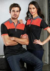 Man and Woman modelling Charger Polo shirts