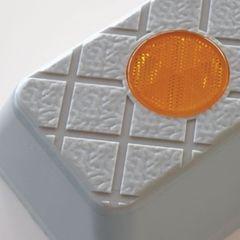 The corner of a grey Plastic Wheel Stop