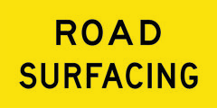 Road Surfacing Sign